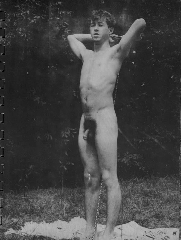 naked man posing outdoors
